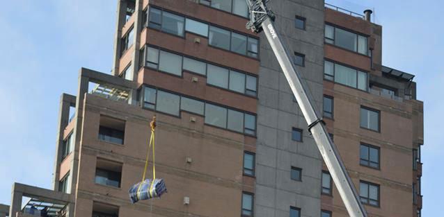 Edgemont Uses Crane to Hoist Sofa 8 Floors